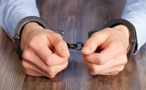 hands-in-handcuffs-624x386
